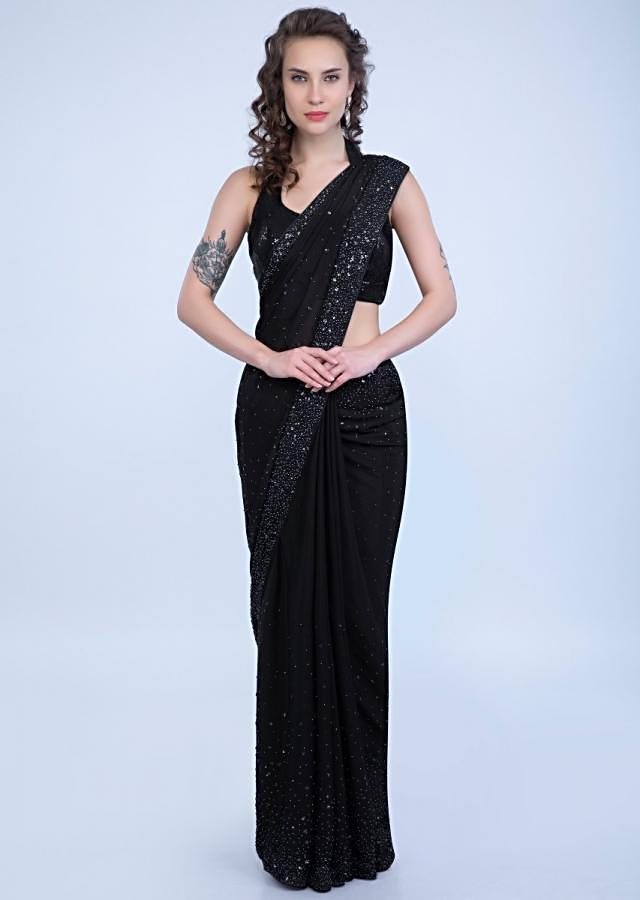 Black satin chiffon saree with self sequins and bead embroidered bottom and pallo only on Kalki