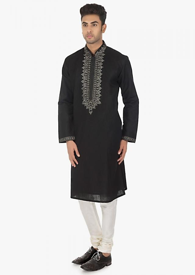 Black silk  kurta with resham embroidery and a matching white chudidar set only on Kalki