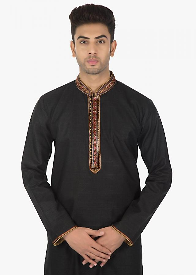 Black silk kurta with a contrasting collar and sleeves matched with a Sandal Brown  chudidar set only on Kalki