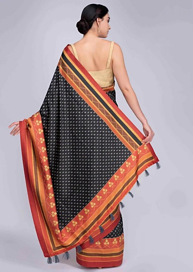 Black silk saree with multi colored striped border only on Kalki