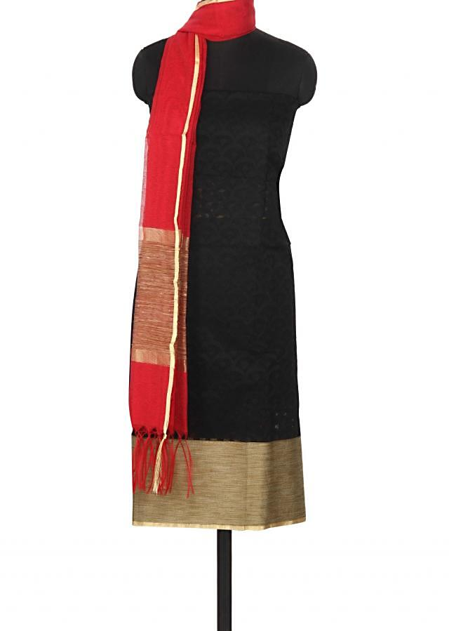 Black unstitched suit features with beige hem line only on Kalki