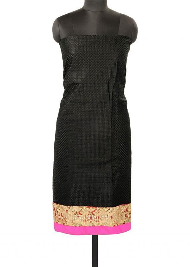 Black unstitched suit with embroidered hem line only on Kalki