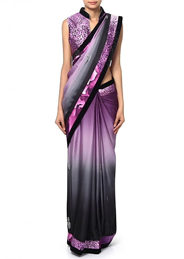Shaded saree in blackpurple satin.enhanced in butti along animal printed border.matched ready blouse in purple animal print front opening in zip.
