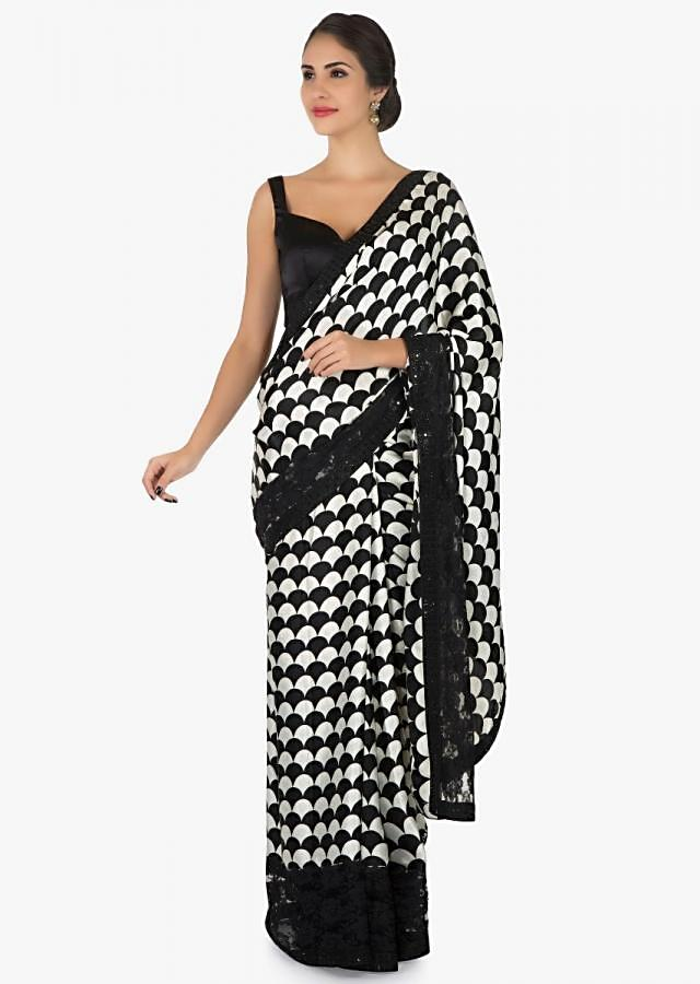 Black and white satin silk saree with unstitched blouse only on Kalki