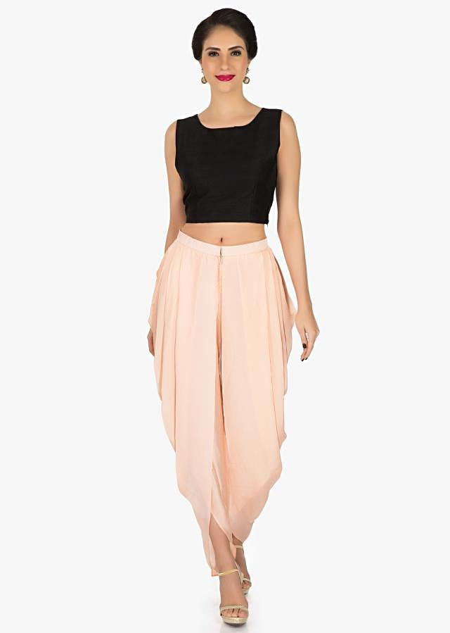 Black cape and peach dhoti suit featuring the moti sequin work only on Kalki