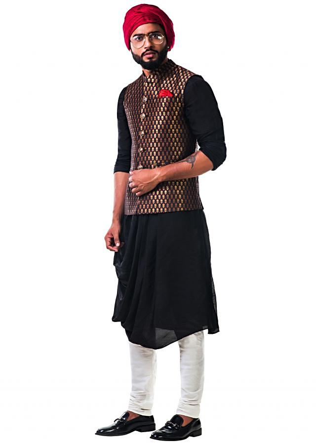 Black cowl kurta set with a black brocade nehru jacket with golden floral motifs only on Kalki