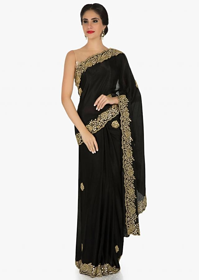 Black georgette saree embellished in cut dana embellishments only on Kalki