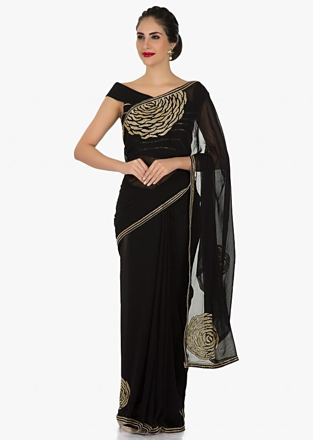 Black Georgette saree featuring the cut dana and rose motif embroidery only on Kalki