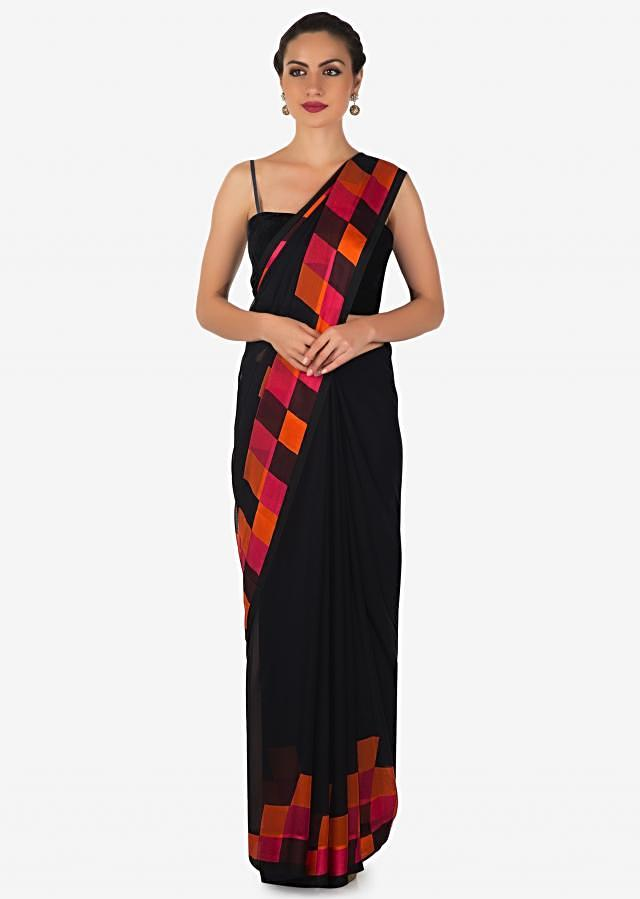 Black georgette saree in pink, mustard and black checks print only on Kalki