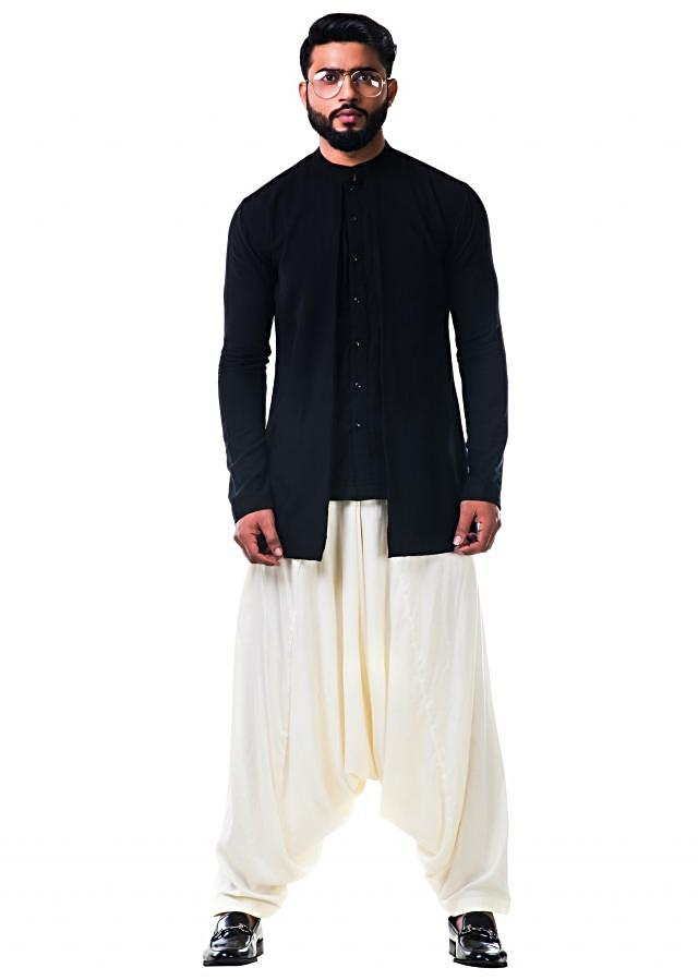 Black khadi both side pleated shirt with a white cowl pant only on Kalki