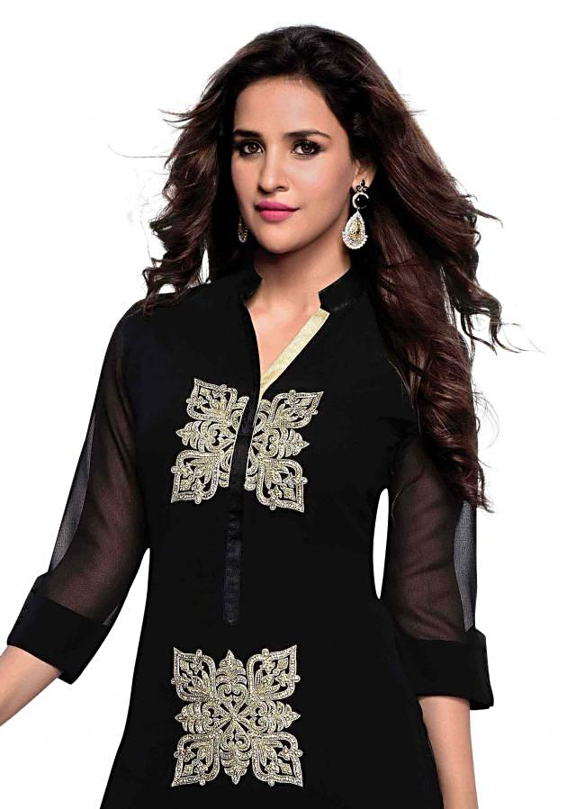 Black kurti features with embroidered butti only on Kalki
