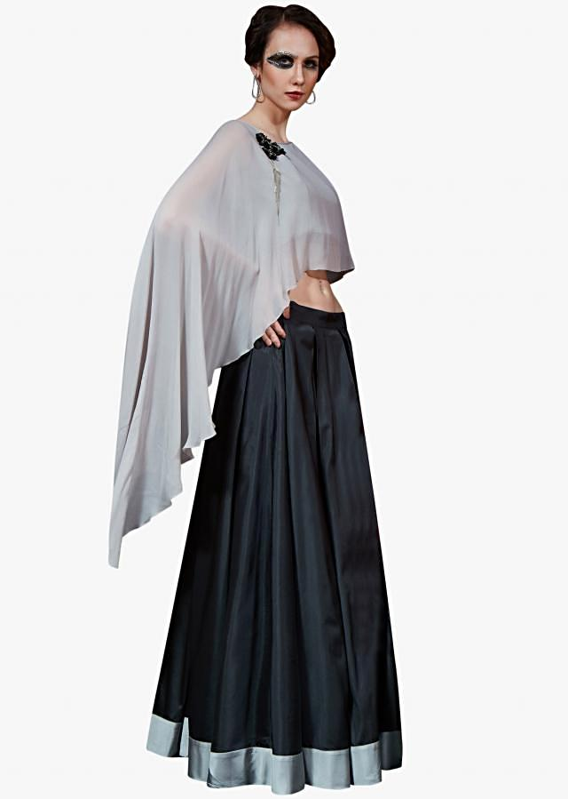 Black long skirt matched with grey cape top adorn in fancy embroidered tassel
