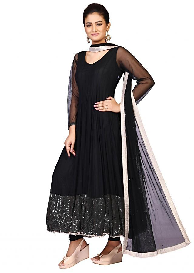 Black net suit with net dupatta enhanced in sequin embroidery only on Kalki