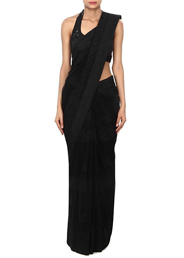 Black saree features in thread embroidery only on Kalki
