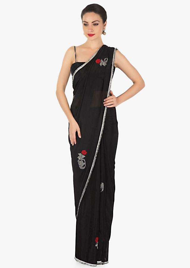 Black saree in chiffon satin with resham and cut dana embroidered butti in rose motif only on Kalki