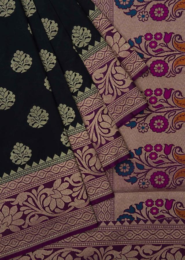 Black saree in silk beautified in weaved embroidery only on Kalki