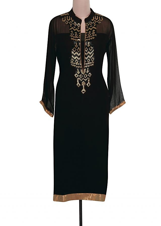 Black semi stitched suit adorn in black and gold kardana only on Kalki