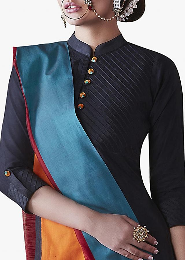Black Suit with multi colored dupatta enhanced in fancy buttons style