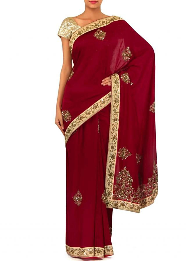 Blood red saree adorn in sequin and zardosi embroidery only on Kalki