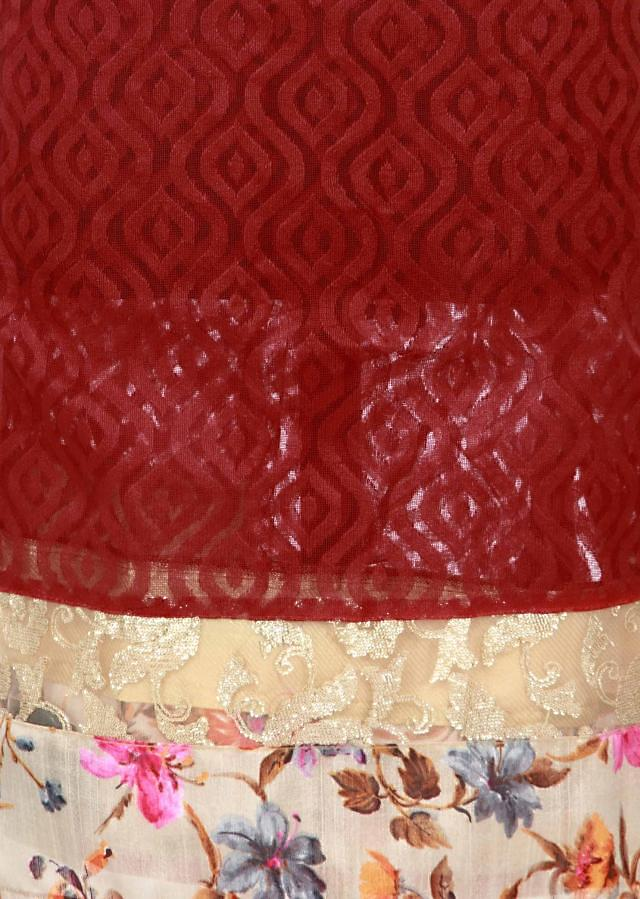Blood red unstitched suit enhanced in print and sequin only on Kalki