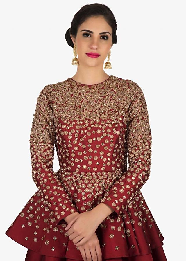 Blood red gown in silk crafted with heavy zari and sequin embroidery work  only on Kalki