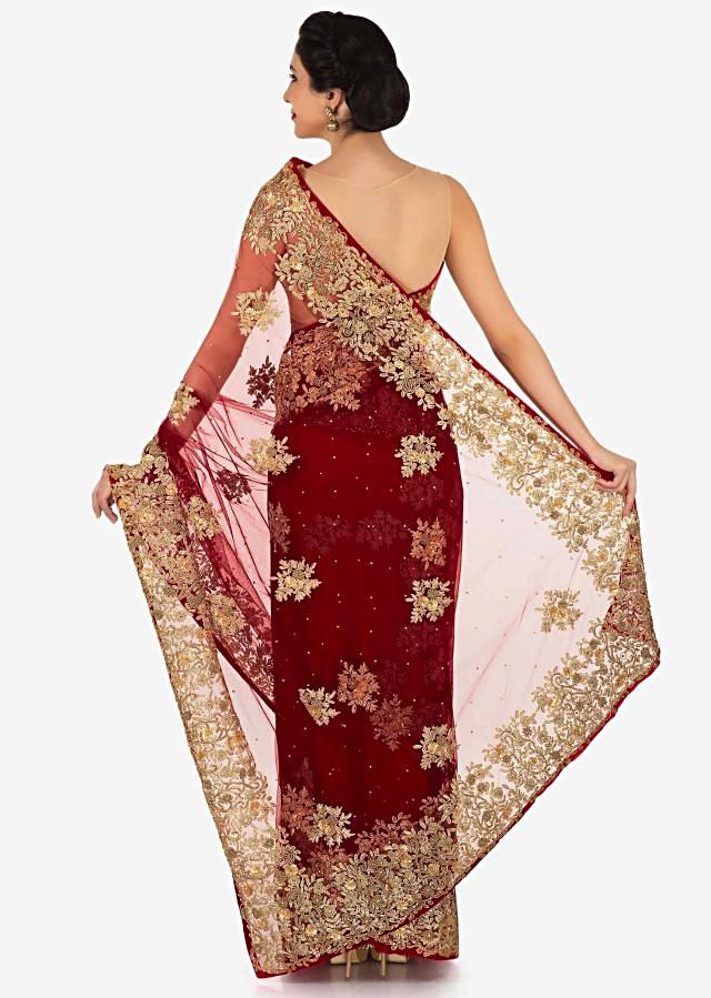 Blood red saree in net adorn in zari and sequin embroidered butti only on Kalki