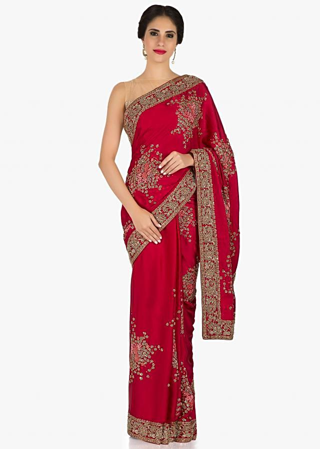 Blood red saree in satin enhanced in french knot and sequin work only on Kalki