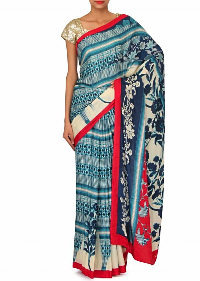 Ocean blue and cream printed saree with rani pink border only on Kalki