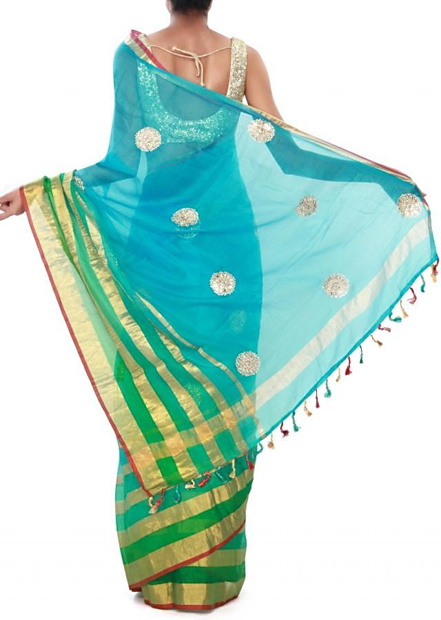 Blue and green saree adorn in mirror work only on Kalki