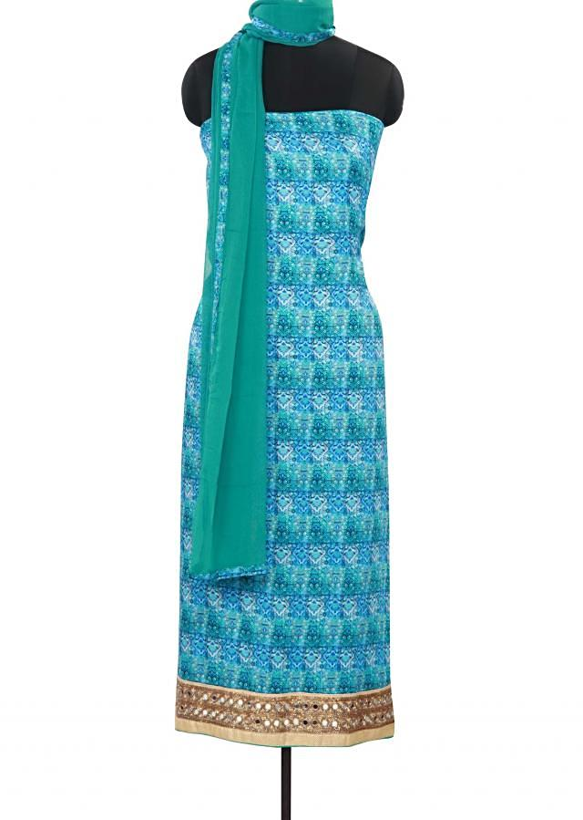 Blue color unstitched suit adorn in mirror and print only on Kalki