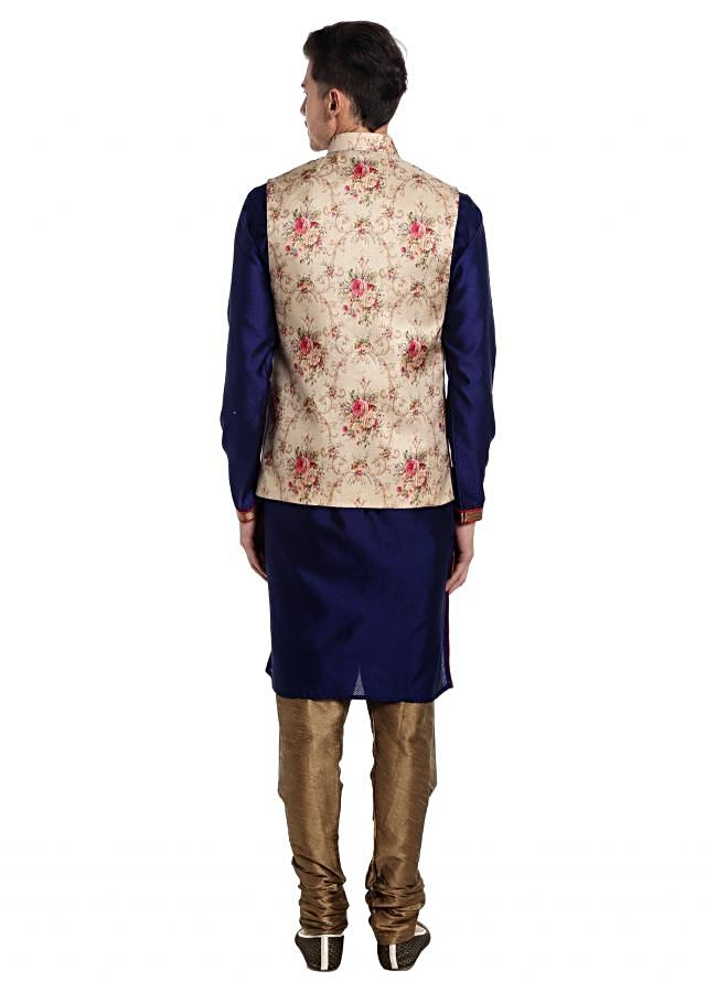 Blue Jacquard Silk kurta Styled with Multi-colored Printed Cotton Waistcoat only at Kalki