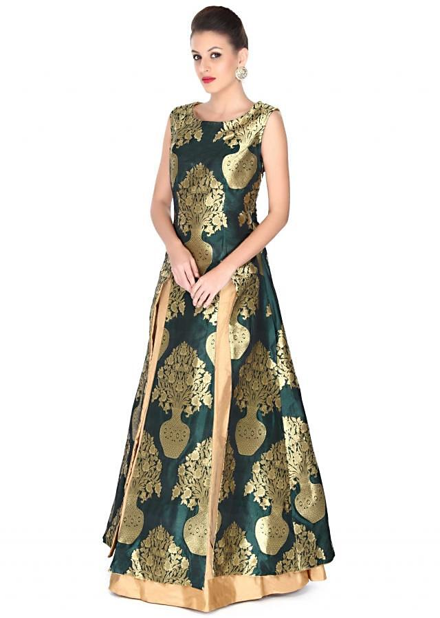 Green long top matched with beige lehenga only on Kalki
