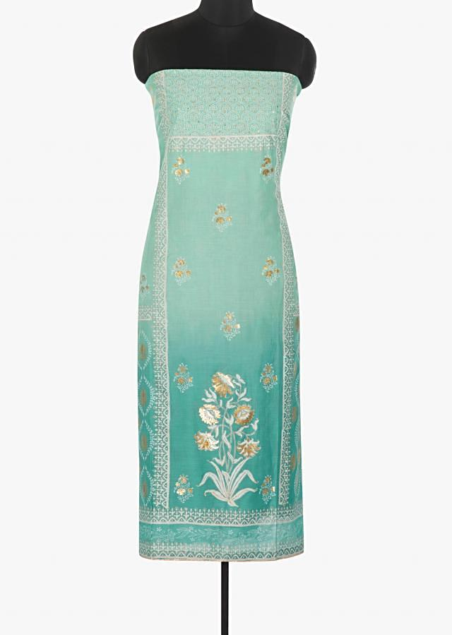 Blue shaded cotton silk unstitched suit embellished in foil printed butti only on Kalki