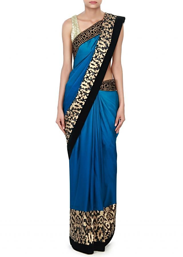 Blue shaded saree adorn in applique embroidery only on Kalki