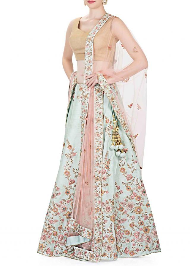 Blue Silk Lehenga, Blouse and Peach Net Dupatta Embedded with Resham Work and Sequins only on Kalki