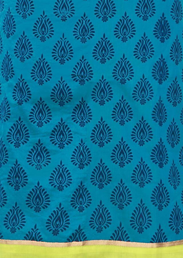 Blue unstitched suit enhanced in self print only on Kalki