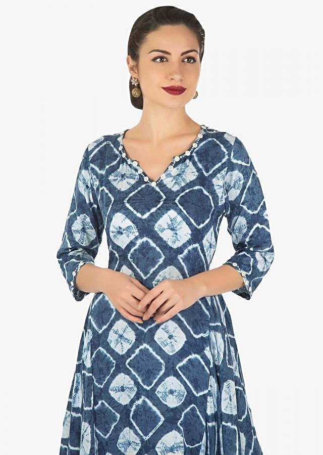 Blue and off white tunic in batik print matched with off white  gotta patch work pants only on Kalki