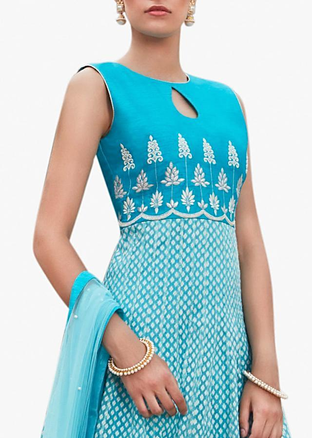 Blue and white anarkali suit enhanced in resham and patch-work embroidery