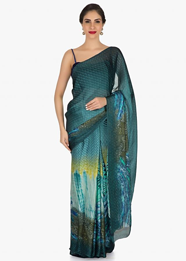 Blue shaded saree with an unstitched blouse featuring beautiful print work only on Kalki