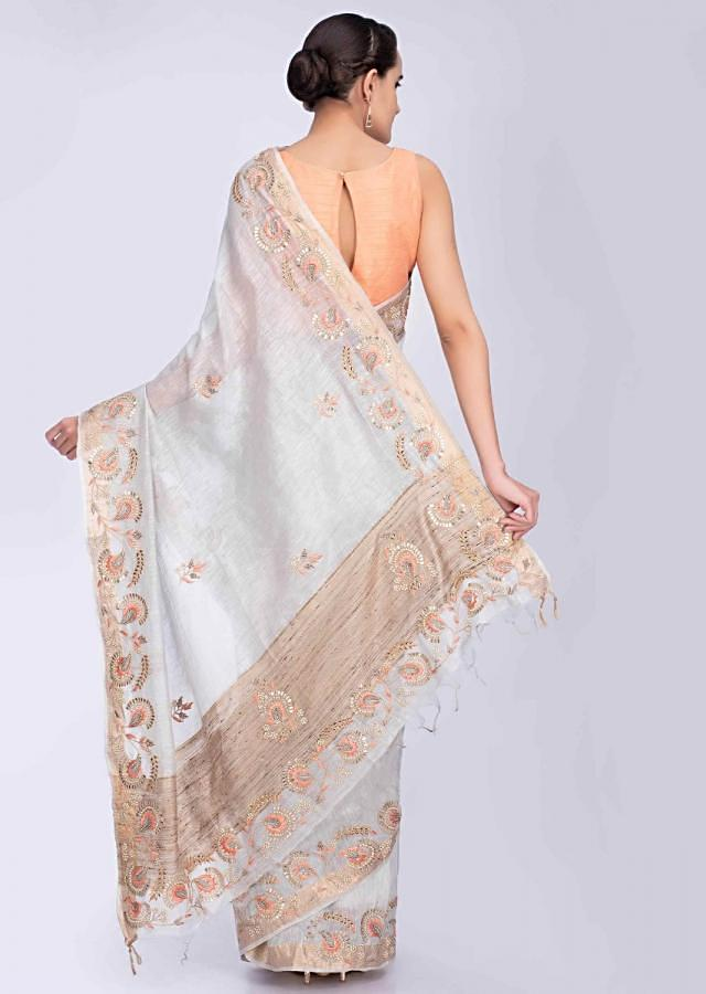 Bluish grey linen saree with floral embroidered butti and border only on Kalki