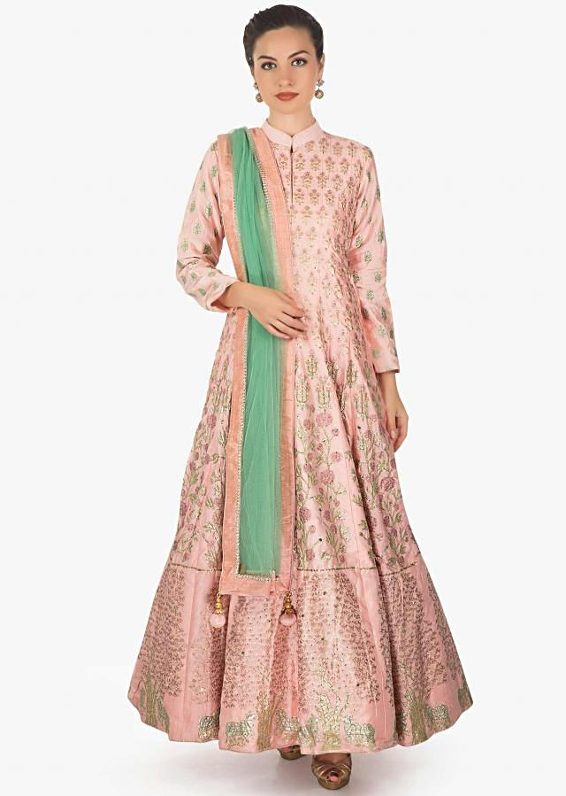 Blush pink cotton silk anarkali paired with a turq net dupatta and lycra chudidar only on kalki