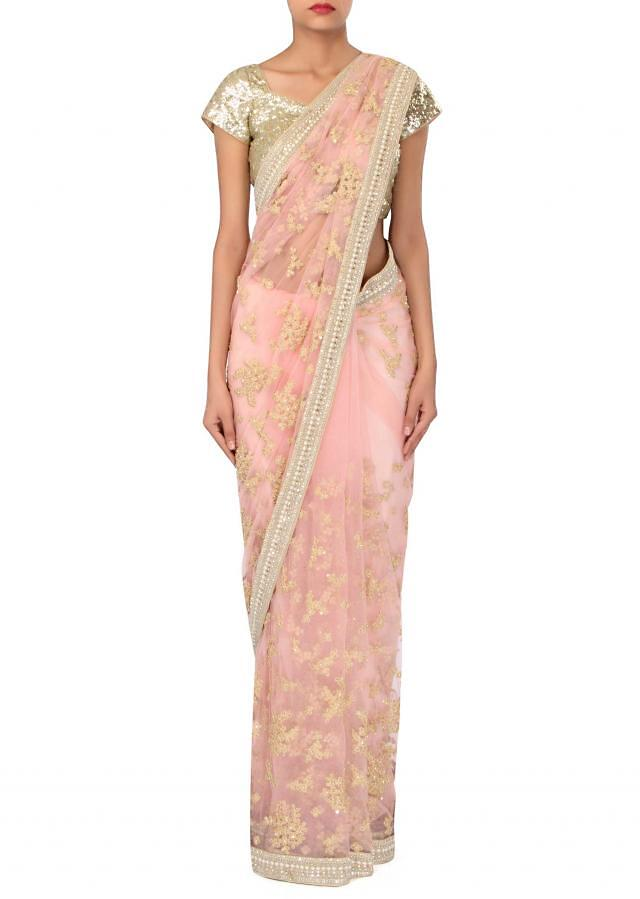 Blush pink saree adorn in thread embroidery only on Kalki