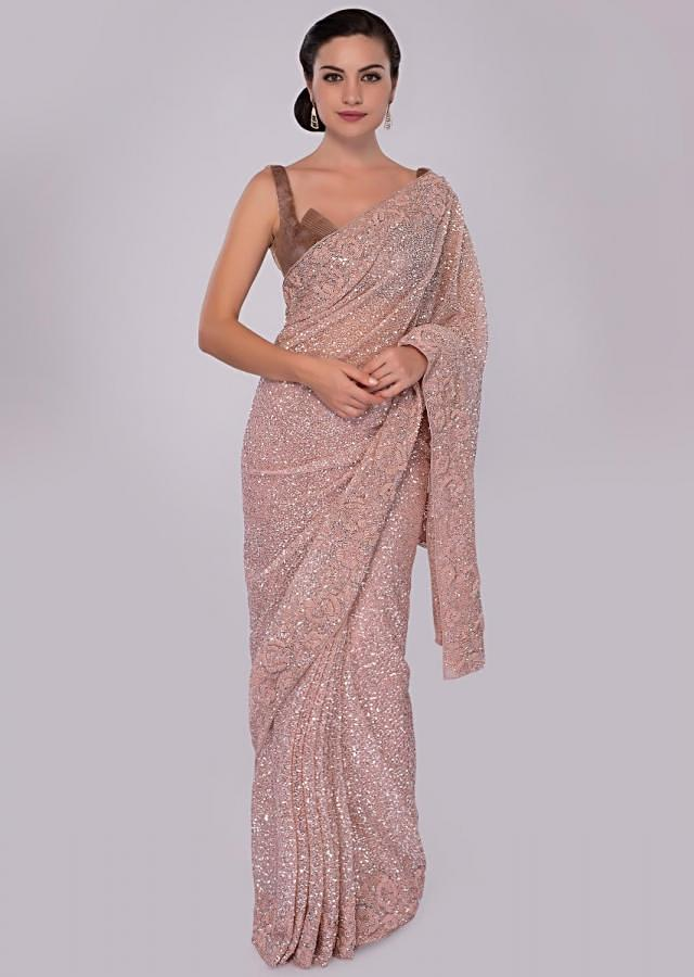 Neeti Mohan in Kalki blush pink hand sequins embroidered saree with spring work border