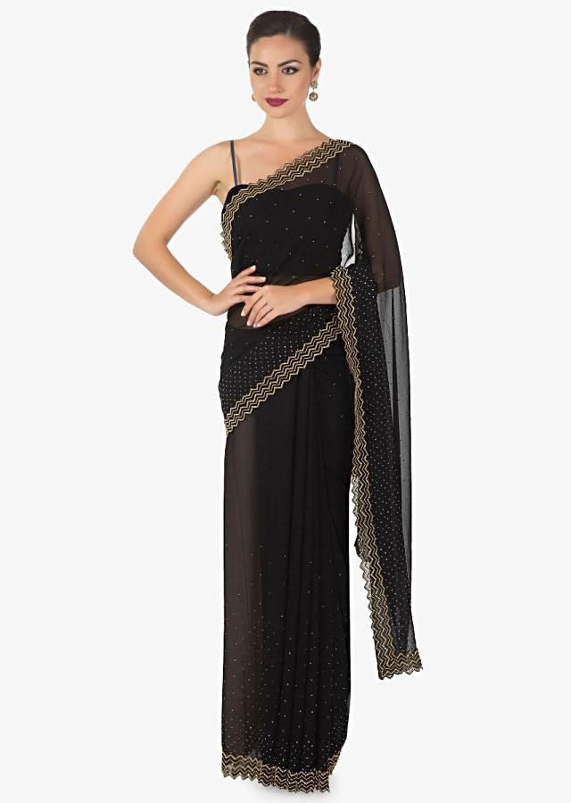 Bold black Cut dana sequin Georgette saree only on Kalki
