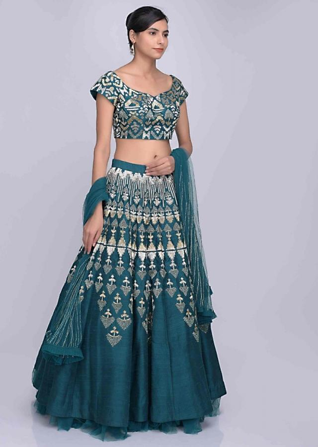 Bottle green raw silk lehenga set with net dupatta only on Kalki