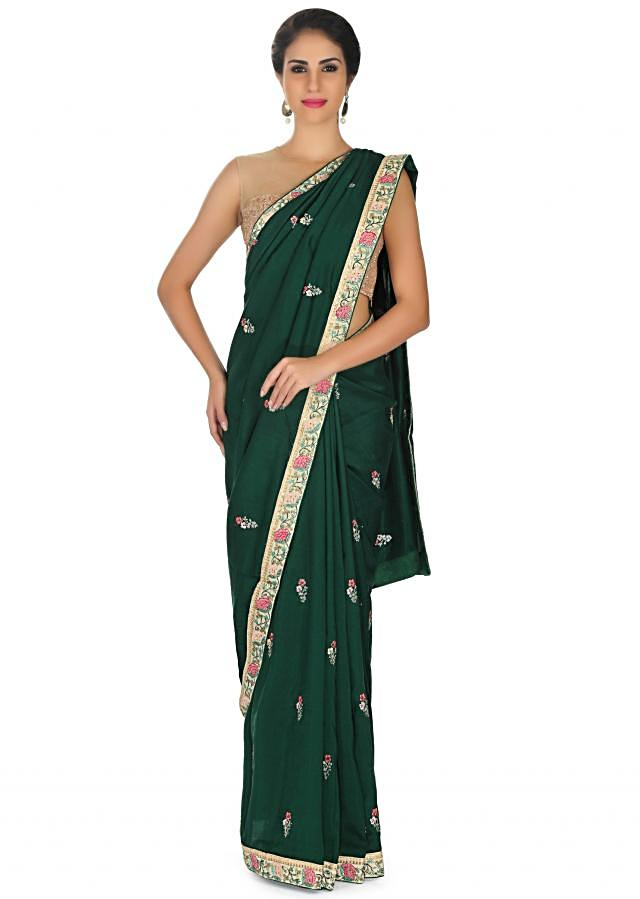 Bottle green saree in georgette with resham embroidered butti only on Kalki