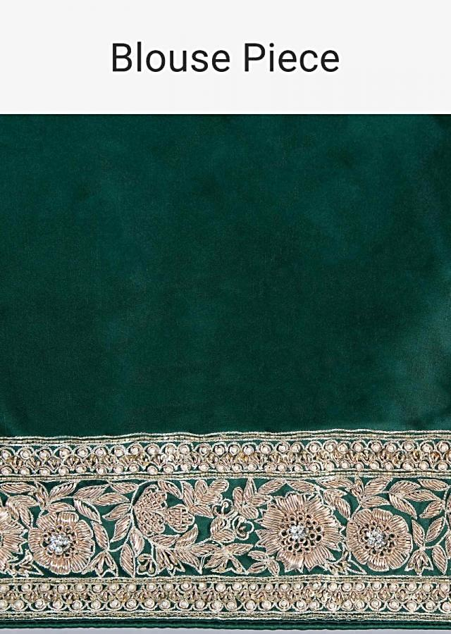 Bottle green satin saree with floral butti and embroidered border only on Kalki