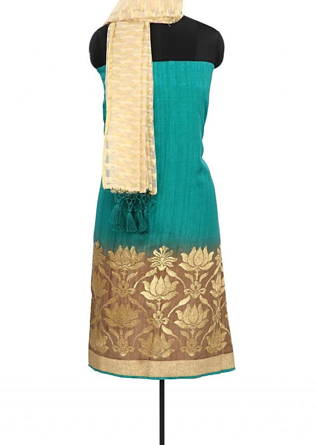 Bottle green unstitched suit enhanced in zari embroidery only on Kalki