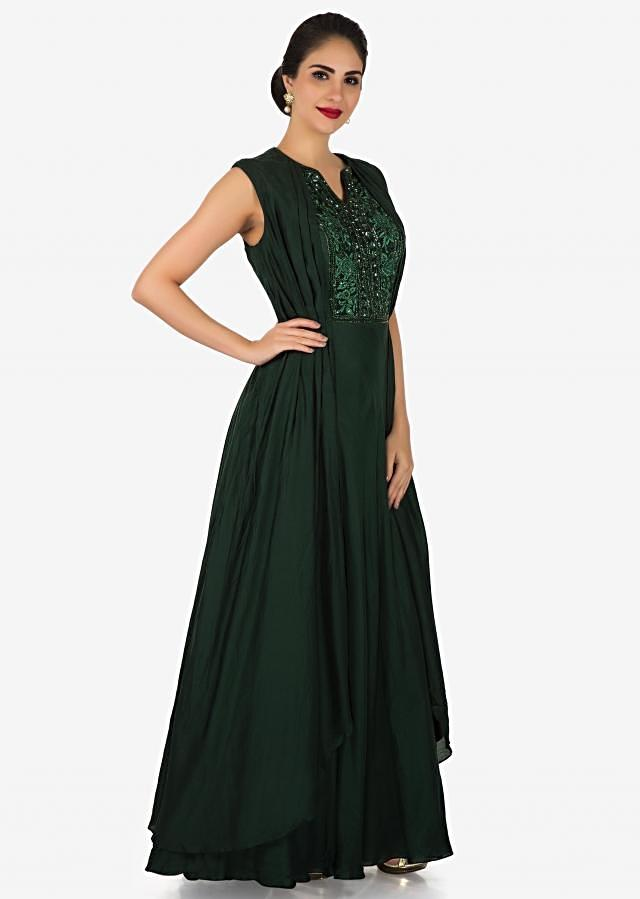 Bottle green cotton gown embellished in resham french knot and zardosi work only on Kalki