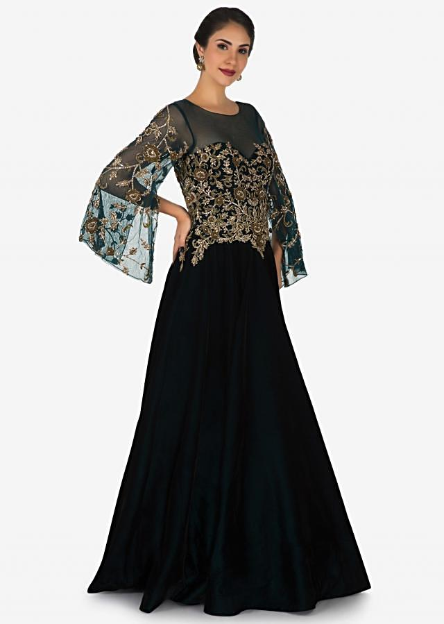 Bottle green gown in velvet designed in heavy zardosi embroidery work only on Kalki